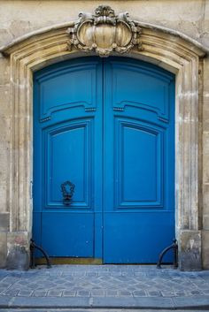 The Blue Door In Marais wall mural is a photograph of an ornate wooden blue door in Paris France. The doors are painted a brilliant blue. The doors are surrounded by detailed stone molding. Old Doors, Windows And Doors, Entrance Doors, Garage Doors, Grand Entrance, Doorway, Unique Doors, Closed Doors, Door Knockers