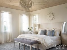 Turner strived for ethereal elegance in the master bedroom. Dressers by Julian Chichester flank a linen bed by Bernhardt. The bench is from Mr. Brown. Overhead, a washed pecky cypress ceiling features a cascading Oly chandelier.