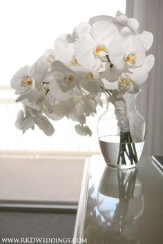Cascading bouquet of white phaleanopsis orchids
