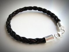 this is so cool! ...brown braided leather bracelet with sterling ends and clasp from JewelryByMaeBee on Etsy. One of a kind for $28.