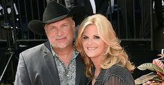 Trisha Yearwood surprises Garth Brooks in concert with the best possible news