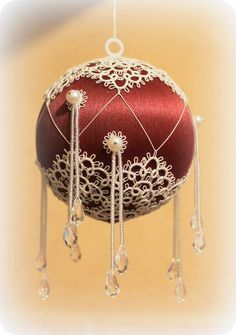 """Tatted by Elena Koval. """"Satin ball, Lizbeth #80, natural pearls, Swarovski crystals, seed beads. Pattern is from """"24 Snowflakes in Tatting"""" by Lene Bjorn"""", but I added one more row to each snowflake."""""""