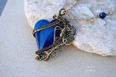 Art Nouveau blue agate heart wire wrapped pendant by IanirasArtifacts on deviantART