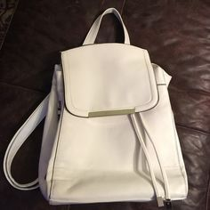 White backpack new Beautiful, white backpack type pursenew, inside and out side zippersdrawstring closure a summer bag! Bags Backpacks