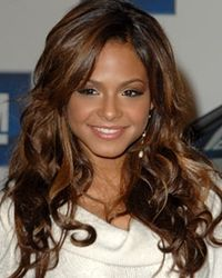 christina milian long dark curly hairstyle with caramel highlights