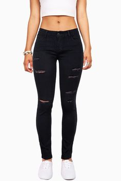 "Mid-rise skinny ankle jeans with a very stretchy jegging fit. Light distressed cuts down the front side. Traditional 5-pocket construction and zip fly closure. *Machine Wash Cold*56% Cotton 23% Polyester 19% Rayon 2% Spandex*38.5"" Top to Bottom 29"" Inseam- Measured on a size 7 (Model is 5'5/wearing a size 3) *Refer to Bottoms Size Chart #1*Imported"