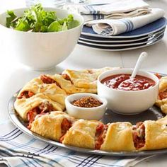 Pizza Ring Recipe Main Dishes with italian sausage, pizza sauce, part-skim mozzarella cheese, canadian bacon, refrigerated crescent rolls