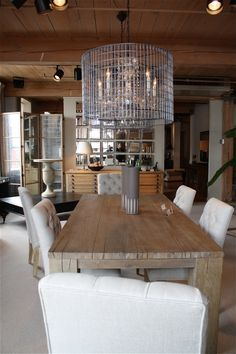 Love the rustic table with contemporary chandy.