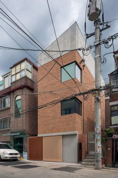 FHHH Friends arranges flexible rooms over split levels at Grown House in Seoul