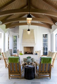 Outdoor living space, cathedral ceiling, stone fireplace, furniture arrangement