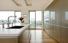 High Gloss Champagne Kitchen with Miele Appliances and Corian Worktops