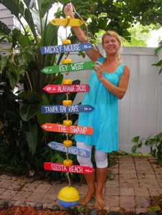 Hanging style mile marker includes your own Personalized Mile Markers strung on a poly-rope with yellow net buoys used as spacers. Each Mile Marker is topped with a directional sign and anchored withOnly on a post, but with more mountainous places :) Pool Signs, Directional Signs, My Pool, Beach Crafts, Outdoor Projects, Beach Themes, Outdoor Fun, Yard Art, Ibiza