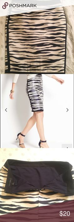 Ann Taylor Zebra Print Pencil Skirt Navy, black, cream and white pencil skirt. Material has a little shine and no give, zips in the back. There is a small stain towards the bottom of the skirt but blends with the cream color pattern and camouflages nicely (shown in close up on pattern). Pet free/smoke free home. Ann Taylor Skirts Pencil