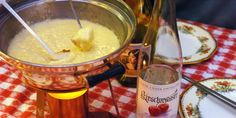 "For best results, make this fondue in a heavy saucepan on top of the stove, and then transfer it to your fondue pot or slow-cooker. The ""winey"" flavor of thi. Gruyere Cheese, Melted Cheese, Fondue, Slow Cooker, Special Occasion, Good Food, Alcohol, Cheese Plates, Dishes"