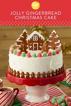 Looking for a gingerbread creation you can enjoy eating with family and friends? Look no further than this Jolly Gingerbread Christmas Cake. Topped with homemade gingerbread cookies and decorated with colorful spice drops and sugar icing decorations, this Christmas Cake Designs, Christmas Cake Decorations, Christmas Cupcakes, Christmas Sweets, Holiday Cakes, Holiday Treats, Christmas Baking, Icing Decorations, Easy Christmas Cake