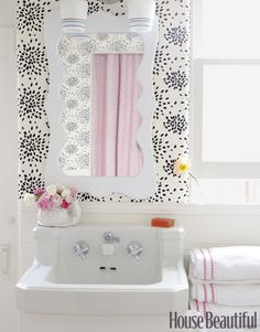 Fireworks wallpaper, mirror, light fixture from Old School Lighting, and Pottery Barn towels