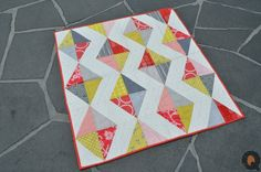 Kite Tails Quilt by The Quilt Engineer.  HRT tutorial - http://themodernquiltguild.com/2012/01/08/100-days-week-of-shapes-tutorial/