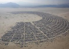 eyewidetonewplaces:  weswegen: An aerial view of the Burning Man 2013 arts and music festival is seen in the Black Rock Desert of Nevada, Au...