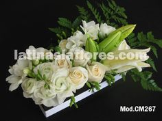 #white ranunculus, freesia, #ivory roses and #white oriental lily #wedding #centerpiece