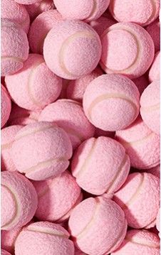 how cute are these pink gumballs shaped like tennis balls? did we mention they're pink lemonade flavored?