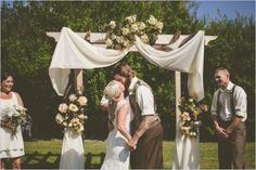 Easy swag on a pergola. rustic backyard wedding ceremony