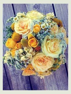Bridal bouquet in shades of yellow and touches of white by Fleurt Floral Art.