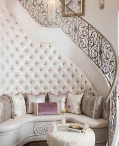 Love this tufted bench at the base of the staircase