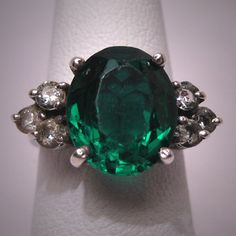 I love this ring, and I would love to have a ring made just like this one! (this one looks chewed up!!) But I love the Emerald with the accent diamonds... so pretty!