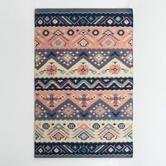 One of my favorite discoveries at WorldMarket.com: Navy and Coral Wool Maracaibo Reversible Area Rug