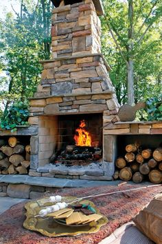 patio with outdoor fireplace. natural stone around the fire and ... - Patio With Fireplace Ideas