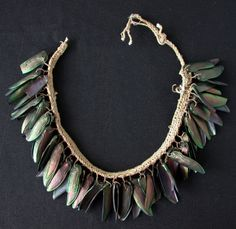Brazil | Necklace or headband from the Tukano people of the Rio Tiquie river region | Beetle wings and cotton (reminds me of pistachio shells)