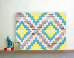 Aztec adds a touch of tribal chic to your home with it's bright Aztec pattern and aged wood background.  Printed onto 100% cotton canvas this design comes in three sizes 30x40cm, 60x90cm and 90x120cm, ready to hang in your home.