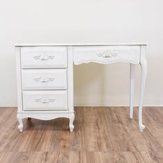 This elegant French Provincial desk is painted in a distressed white. The desk features 4 drawers for holding your supplies. The legs are in good shape. There is some wear on the finish. A sweet desk for your home office! #frenchprovincial #desks #kneeholedesk #sandiegovintage #vintagefurniture