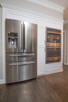 stove top sink and dishwasher on one wall woth fridge and built in oven across