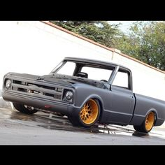 67 chevy C10 slammed matte flat black with gold mesh wheels