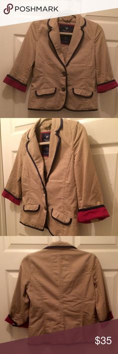 American Eagle blazer. M. Nice khaki blazer with navy and fuchsia satiny detail. The sleeves do fold down and have buttons. 3/4 length sleeves. Great with jeans and a tank. Excellent condition. American Eagle Outfitters Jackets & Coats Blazers