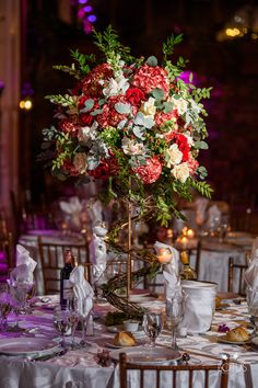 Gorgeous fall style centerpiece with spiral stand. Flowers used are red hydrangea, red roses, white snapdragon, dusty miller, vendella roses, red hypericum and greenery. Centerpiece Ideas, Centerpieces, Table Decorations, Red Hydrangea, Dusty Miller, Red Roses, Spiral, Greenery, Autumn Fashion