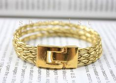 Gold bracelet with gold braid leather and gold plated by Showrist, $9.00