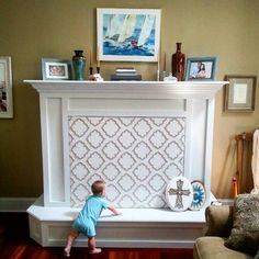 Fireplace Baby Proofing- Here is my quick solution to keep my newly crawling baby out of the fireplace! I cut and taped foam board to fit the size of the opening. I hot glued magnets to the edges of the foam board to hold it in place since our gas log insert is magnetic. I wrapped the foam board in fabric and hot glued the edge of the fabric to the back of the foam board. It really was a simple fix!