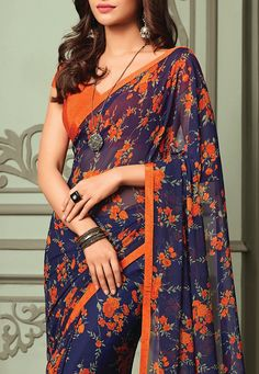 Printed Georgette Saree in Navy Blue Simple Sarees, Trendy Sarees, Fancy Sarees, Floral Print Sarees, Saree Floral, Cotton Saree Blouse Designs, Bollywood Designer Sarees, Saree Photoshoot, Saree Trends