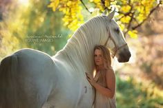 Pretty horse photography. White horse and girl nuzzled up.