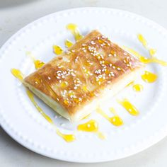 Phyllo wrapped feta cheese with honey and sesame seeds is a favorite Greek cheese appetizer of ours. The perfect combination of phyllo, cheese, honey, and sesame seeds.