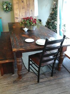 """Here is an example layout of a farm table/harvest table custom made from reclaimed barn wood - flooring, beams, rafters. Made from white pine, the table features a dark tudor, medium character, 2"""" top with 5"""" turned legs, a bench, and a Manhattan ladder back chair, all custom made by E. Braun Farm Tables - showroom located in the heart of Amish country, Lancaster County, PA. www.braunfarmtables.com"""