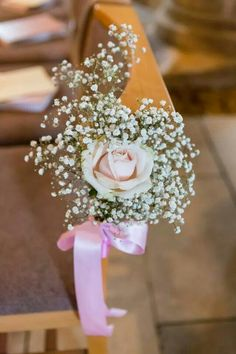 Pink rose and baby's breath wedding pew ends