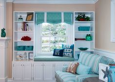 window seat with turquoise accents | QualCraft Construction