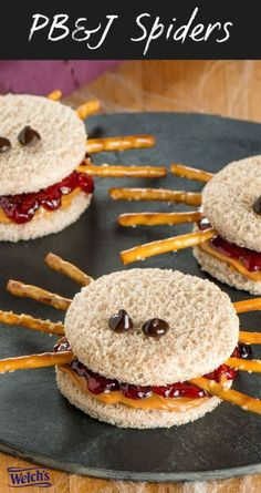 PB & J Spiders: Here's how to ensure your kid's lunch is the envy of all the other kids in his class.This healthy snack is perfect for kids at school and at Halloween parties. Filled with yummy and natural jam and topped with pretzel sticks this Halloween inspired snack is yummy and spooky. Find more healthy Halloween inspired snacks for kids here.