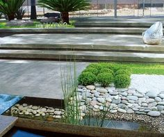 Love all those textures combined! Concrete stairs, water feature, river rocks, landscape architecture.