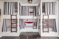 Bunk room with six bunk beds. Each bunk has its own hand aged brass sconce and charging station. Bunk room with smart bunk bed layout sleeping six. Bunk Bed Curtains, Bunk Bed Rooms, Pleated Curtains, Bunk Bed Wall, Sleepover Room, Alice Lane Home, Built In Bunks, Bunk Bed Designs, Bedroom Designs