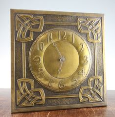 <b>Margaret Gilmour A Scottish Arts & Crafts brass 'wag at the wa' wall clock,</b> embossed with celtic knot motifs and circular numeral dial, with associated weights and pendulum, impressed with the mark MG, Craftsman Clocks, Craftsman Style, Arts And Crafts Furniture, Diy Arts And Crafts, Glasgow School Of Art, Glasgow Girls, Jugendstil Design, Antique Clocks, Antique Mantel