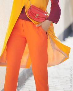 This outfit is analogous because it uses a red top, red-orange bag, orange pants, and yellow blouse Orange Color Combinations, Color Combinations For Clothes, Color Blocking Outfits, Spring Fashion Outfits, Chic Outfits, Autumn Fashion, Yellow Blouse, Orange Dress, Orange Pants